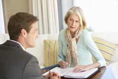 Senior Woman Meeting With Financial Advisor At Home Stock Photos