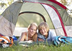 Teenage Couple On Camping Holiday In Countryside Stock Photos