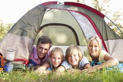 Middle Aged Family On Camping Holiday In Countryside Stock Photos