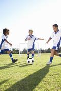Group Of Boys Playing Football Kuvituskuvat