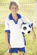 Young Boy Dressed In Soccer Kit Standing By Goal Kuvituskuvat