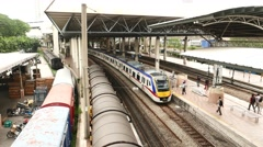 Express Rail Link station train arrive, view from above, platform perspective Stock Footage
