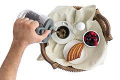 Man pouring fresh breakfast coffee Stock Photos