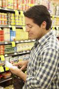 Man shopping in supermarket Stock Photos