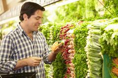 Man Shopping For Produce In Supermarket Kuvituskuvat