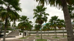 National Mosque, exterior view through surrounding palm trees, sliding shot Stock Footage