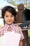 Hispanic Boy Checking Mailbox - stock photo