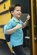 Elementary School Pupil Board Bus - stock photo