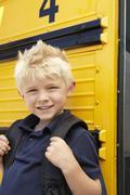 Elementary School Pupil Board Bus Stock Photos