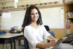 Elementary School Teacher In Computer Class Stock Photos