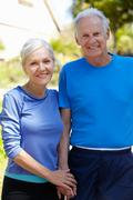 Elderly man and younger woman outdoors Stock Photos
