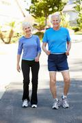 Elderly man and younger woman jogging Stock Photos