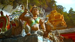 Stock Video Footage of Fierce Looking Hindu Statues outside a Temple