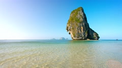 Massive Limestone Rock Formations Towering over Tropical Beach Stock Footage