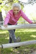 Senior African American Woman Exercising In Park Stock Photos
