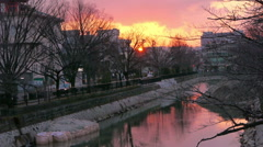 Time Lapse of Sunset over River in Kyoto, Japan - stock footage