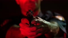 Close up of a police officer's hands on a hand gun Stock Footage