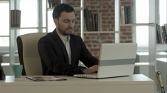 Happy business man finished his work in office with notebook Stock Footage