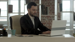 Businessman finished work in front of a laptop Stock Footage