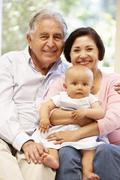 Hispanic grandparents at home with grandchild Stock Photos