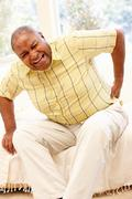 Senior African American man with backache - stock photo