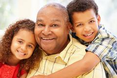 Senior African American man and grandchildren - stock photo