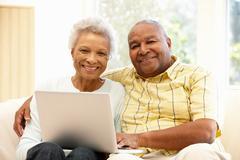 Senior African American couple using laptop Stock Photos