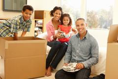Mixed race family in new home - stock photo