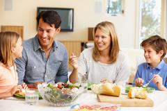 Family sharing meal Stock Photos
