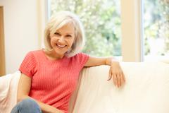 Mid age woman at home - stock photo
