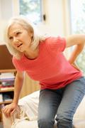 Mid age woman with backache Stock Photos
