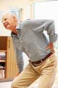 Senior man with backache - stock photo