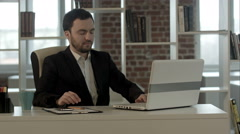 Businessman on video conference with his colleague in office job Arkistovideo