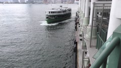 Hong Kong's Star Ferry; the Morning Star arrives in Central Stock Footage