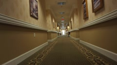 Walking down a hall of an assisted living facility Stock Footage