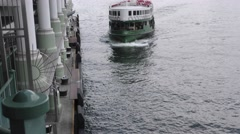 "The Hong Kong Star Ferry ""Solar Star"" arriving at Pier 7 in Central District. Stock Footage"