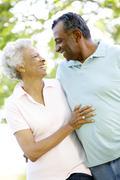 Romantic Senior African American Couple Walking In Park Stock Photos