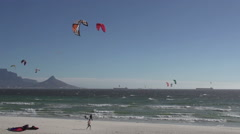 Windsurfers on the famous Bloubergstrand with Table Mountain in the background, Stock Footage