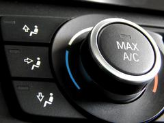 Car parts detailing. Air conditioner control system in car - stock photo