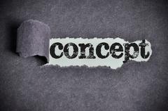 Concept  word under torn black sugar paper Stock Photos