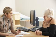 Senior woman visiting Doctor Stock Photos