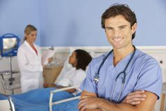 Portrait male doctor working in hospital - stock photo