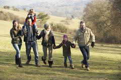 3 Generation family on country walk in winter - stock photo