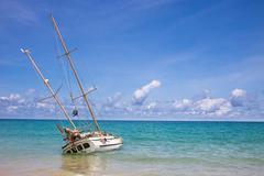 Abandoned shipwreck on the coast at kata beach Phuket Thailand, tourist landm Stock Photos