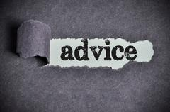 advice word under torn black sugar paper - stock photo