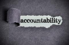accountability word under torn black sugar paper - stock photo