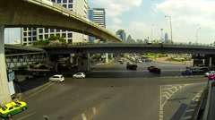 BANGKOK - March 2015: Bangkok's traffic with BTS sky trains passing by. Silom Stock Footage