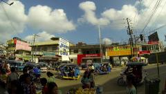PUERTO PRINCESA - February 2015: Street view with people, and tricycles. Stock Footage
