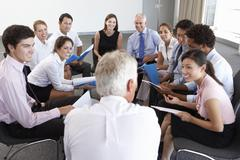 Businesspeople Seated In Circle At Company Seminar Stock Photos
