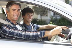Father On Car Journey With Teenage Son - stock photo